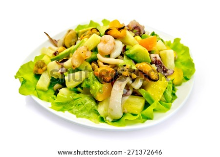 Salad with shrimps, octopus, mussels and calamari with avocado, lettuce, pineapple in a bowl isolated on white background - stock photo