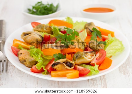 salad with shrimps on the white plate