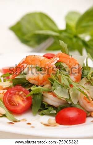 Salad with shrimps, rucola and tomato - stock photo