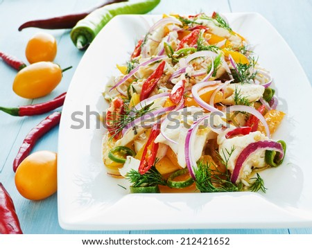 Salad with steamed mackerel icefish fillet, veggies and herbs. Shallow dof.