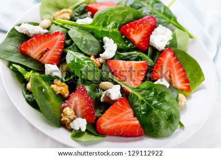 salad with strawberry, spinach leaves and feta cheese - stock photo