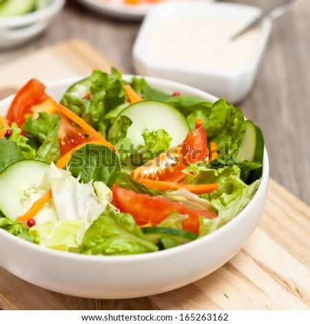 Salad with tomato, cucumber and carrots - stock photo