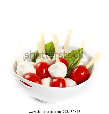 Salad with Tomato, Mozzarella and Basil on white background. Selective focus. - stock photo
