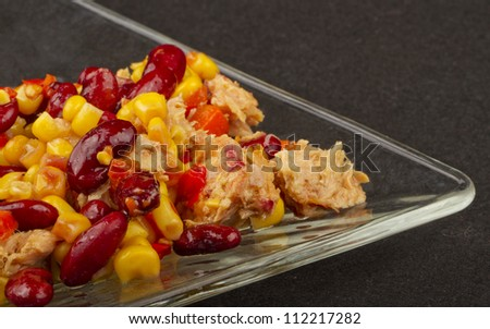 Salad with tuna, corn and beans - stock photo