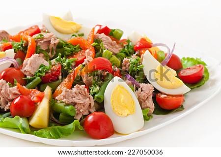 Salad with tuna, tomatoes, potato and onion - stock photo