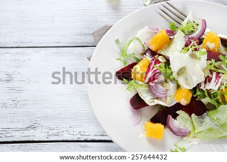 Salad with vegetables and fruits, sweet food - stock photo