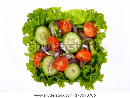 salad with vegetables and greens on the white background - stock photo