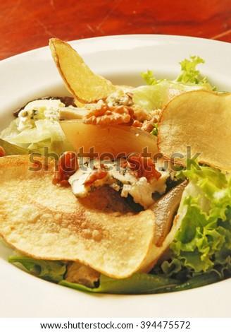 salad with walnuts and gorgonzola - stock photo