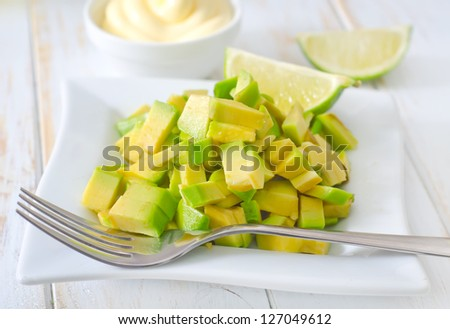 salad with white sauce and avocado - stock photo