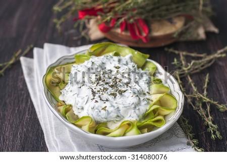 salad with zucchini and yogurt. Selective focus - stock photo