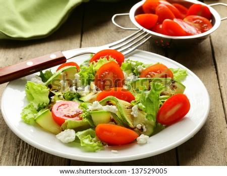 salad zucchini  with tomatoes and soft cheese