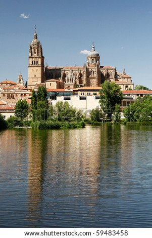 Salamanca Cathedral reflecting in the Tormes river - stock photo