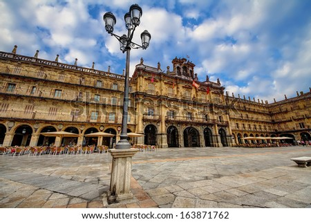 """SALAMANCA, SPAIN - SEPTEMBRE 12: The """"Plaza Mayor""""  of the capital is the most amazing square to take a drink or watch their famous architecture, on september 12, 2013 in Salamanca. - stock photo"""