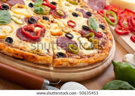 salami and vegetable  pizza with ingredients - stock photo