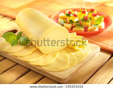 Salami cheese on kitchen board with - stock photo