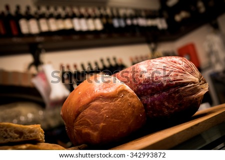 Salami on a bar in a Florence shop. - stock photo