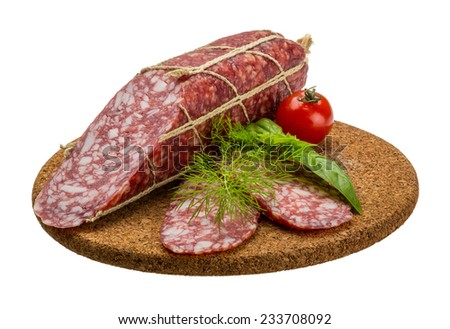 Salami sausages sliced with basil - stock photo