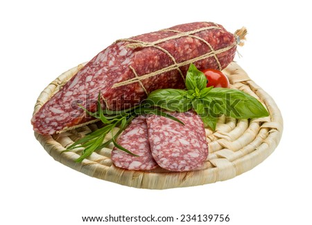 Salami sausages sliced with basil - stock photo