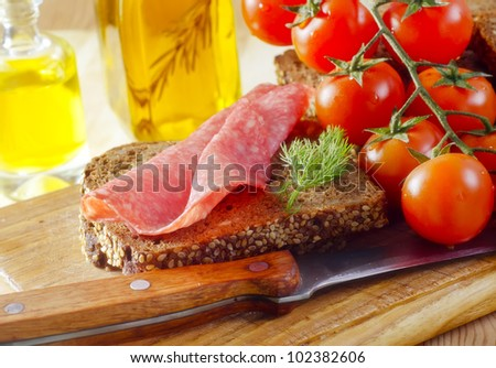 salami with bread - stock photo