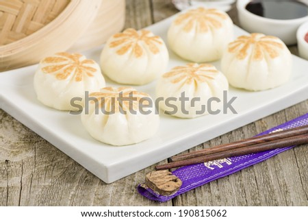 Salapao - Thai steamed buns filled with chicken. - stock photo