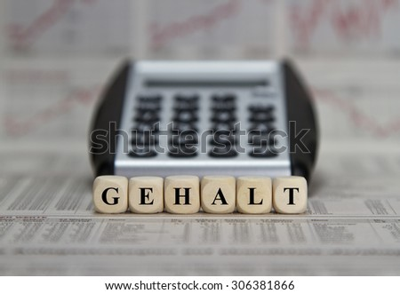 Salary word built with letter cubes - stock photo
