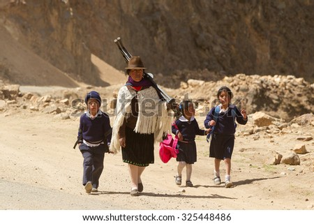 Salasaca, Ecuador - 17 October 2012: Mother With Children Coming Back From School Are Forced To Walk Miles Due To The Lack Of Public Transportation In The Area In Salasaca On October 17, 2012 - stock photo