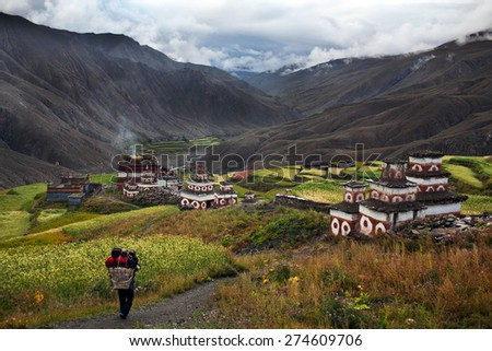 Saldang village in Dolpo, Nepal. Saldang lies in Nankhang Valley, the most populous of the sparsely populated valleys making up the culturally Tibetan region of Dolpo. - stock photo