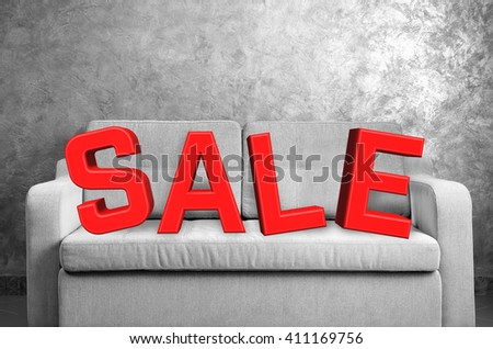 Sale concept. Comfortable sofa against grey wall in the room - stock photo