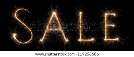 Sale label isolated on black collected from sparks - stock photo