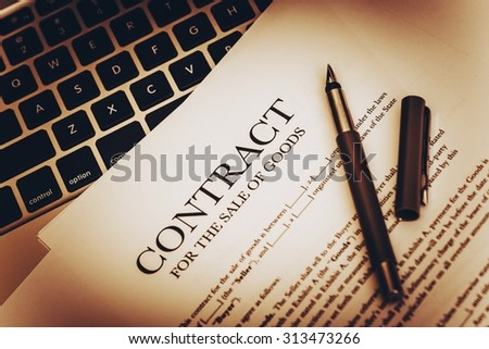 Sale of Goods Documents. Contract of Sale of Goods Closeup Photo. - stock photo