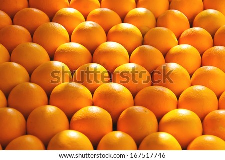 Sale of ripe oranges on the market - stock photo