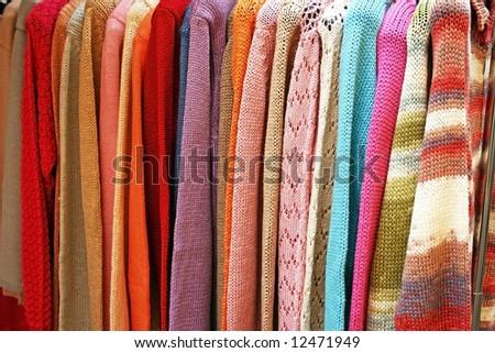 Sale of winter clothing closeup. - stock photo