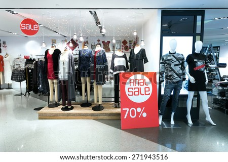 sale poster board at fashion clothes shopfront - stock photo