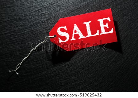 Sale price tags on dark background