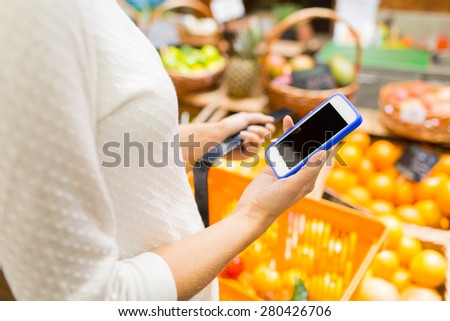 sale, shopping, consumerism and people concept - close up of young woman with food basket in market - stock photo