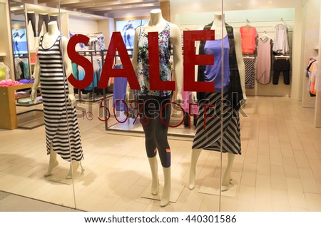 sale sign and showcase model at shop  - stock photo