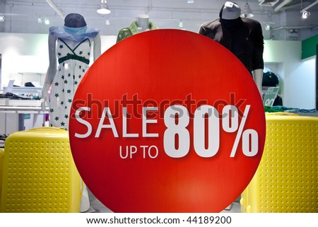 Sale sign on the clothes shop window. Shopping collection. - stock photo