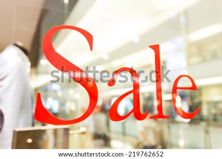 sale sign  on the shop window - stock photo