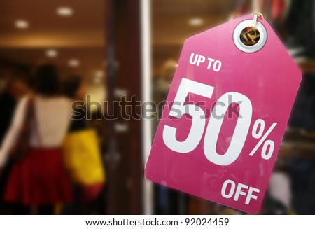 Sale signs in shop window, big reductions - stock photo