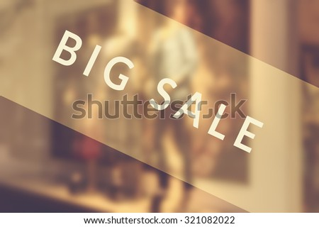 Sale signs in shop window. Selective focus. - stock photo