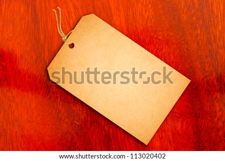 Sale Tag on texture of wood - stock photo