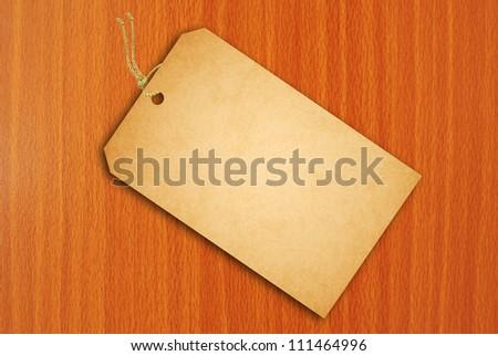 Sale Tag on wood texture - stock photo