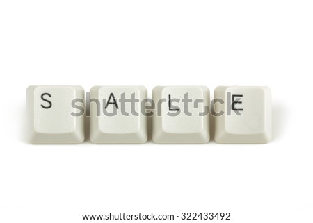 sale text from scattered keyboard keys isolated on white background