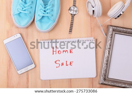 Sale unwanted stuff on wooden background top view - stock photo