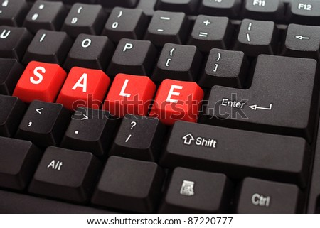 sale word on black keyboard and red button
