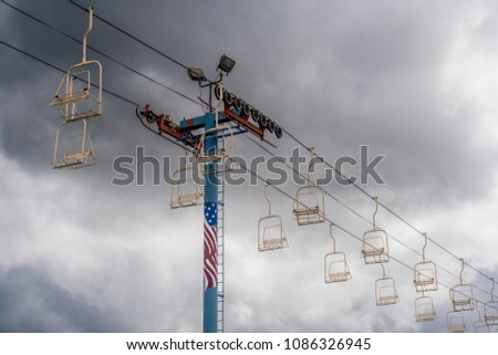 SALEM, OREGON - April 29, 2018: Oregon State Fair empty overhead baskets ride in spring before opening with dark cloudy sky.