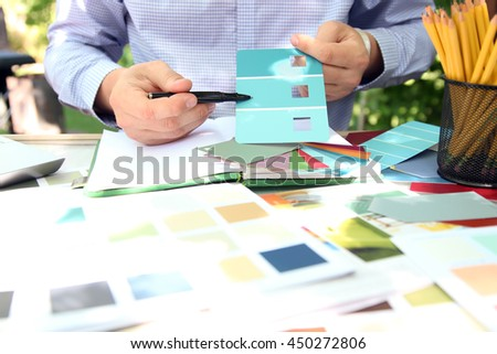 sales agent  choosing color samples for design project.