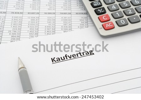 sales agreement - Kaufvertrag - in german with calculator and pen - stock photo