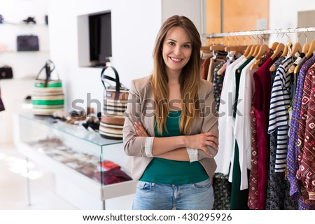 Sales assistant in clothing store  - stock photo