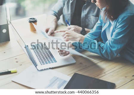 Sales Department Work Process.Photo traders reading market report modern laptop.Using electronic devices.Working graphics,stock exchanges data reports.Business project startup.Horizontal,film effect. - stock photo